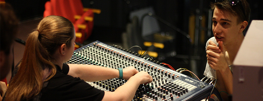Live production students working on sound board