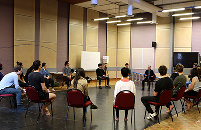 Rowena Balos with NIDA students